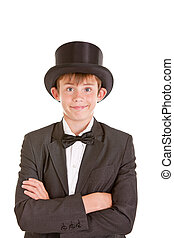 Dapper confident young boy in a top hat, bow tie and black...