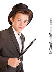 Cute young boy dressed as a magician in a top hat and jacket...