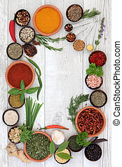 Herbs and Spices - Herb and spice selection in bowls with...