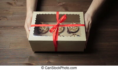 Male hands showing and giving gift on Wood background - Male...