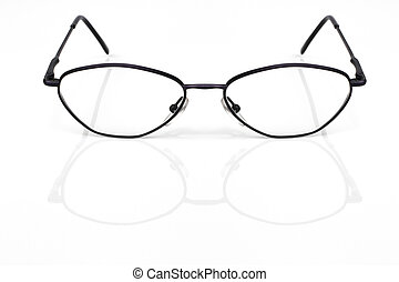 Eyeglasses closeup on a white background with reflection