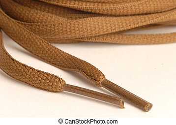 brown or tan shoelaces isolated on a white background