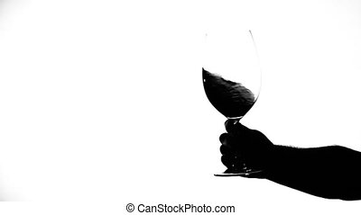 Wine glass with red wine, white, silhouette, slowmotion -...