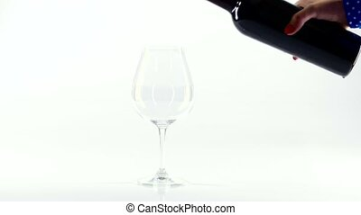 Person pour red wine into a glass, white - Person pour red...