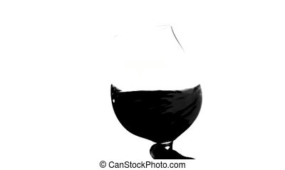 Red wine glass silhouette, white, closeup - Red wine glass...