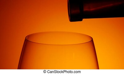 Pouring wine into a glass, dark , slowmotion, closeup -...
