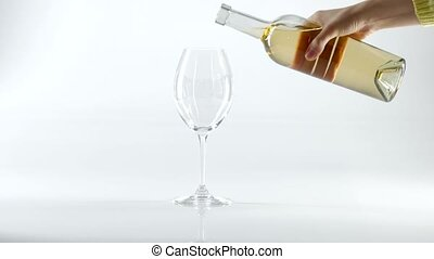 White wine poured into glass, white - White wine poured into...