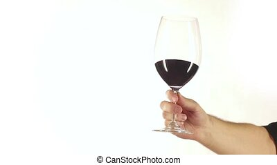 Glass of red wine with splashes in hand, white, slowmotion