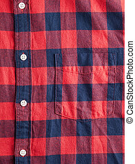 Texture of checkered flannel shirt with buttons and pocket