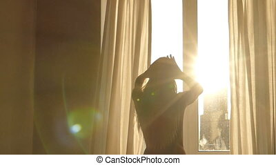 Woman wakes up, Silhouette of woman against window - Woman...