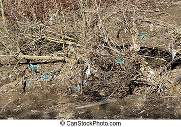 Plastic Litter along a waterway Environment Damage - Harmful...