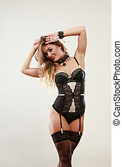 Smiling girl wearing sexy lingerie - Sexuality concept...