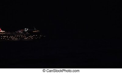 Cruise Ship at night moving through the frame left to right