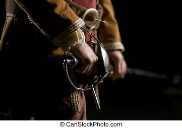 Musketeer o Swordsman over a Black Background - European...