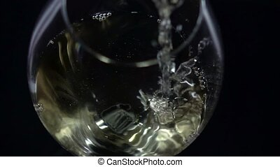 White wine being poured into a wineglass, bubble, view from...