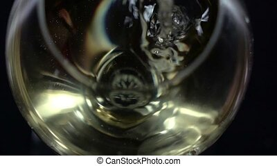 White wine being poured into a wineglass, bubble, bottom...