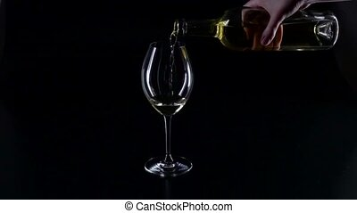 Pouring white wine into a glass, black, silhouette, slowmotion