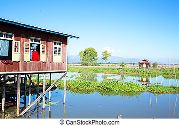 Traditional floating village houses in Inle Lake, Myanmar