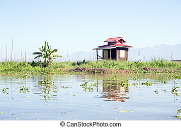 Traditional floating village house in Inle Lake, Myanmar