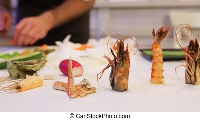 Seafood on cutting board, cam moves to the left, closeup -...