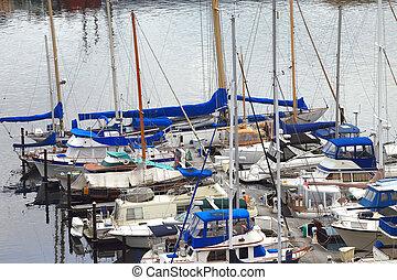 Yachts & sailboats. - Moored sailboats in Tacoma bay.