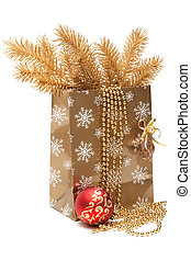 Cristmas gift package, fur branches on white background