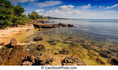 Rocks under Transparent Shallow Water near Beach