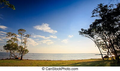 Cumulus Clouds over Azure Sea from Grass Beach - motion of...