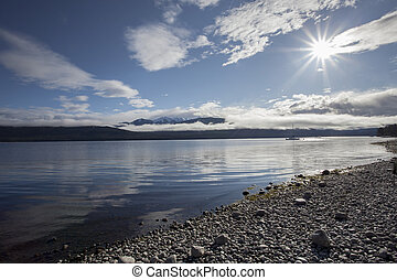 sun light over lake te anau fiordland national park new...