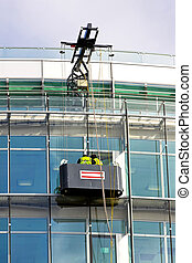 Window cleaning - Window washers in elevator washing windows...