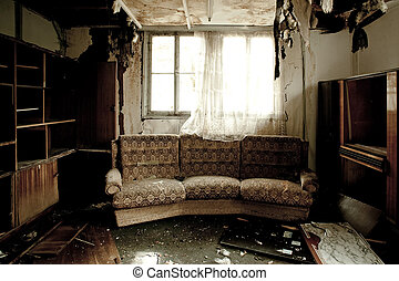 Room after a fire - View into a burnt-out room with sofa