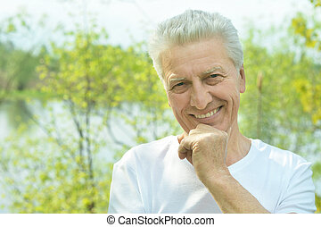 smiling elderly man - Portrait of smiling elderly man near...