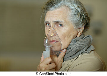 Woman making inhalation - Portrait of a sick old woman...
