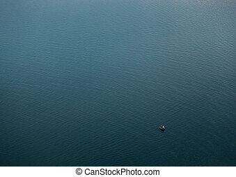 Fishermen at boat on the blue big lake