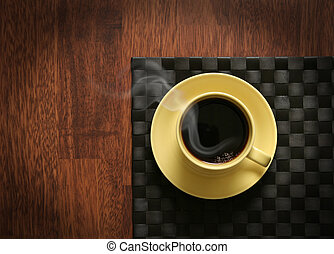 Steaming hot coffee - Steaming hot cup of black coffee on...