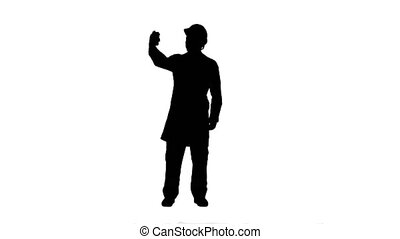 Silhouette Engineer or architect taking a selfie showing...
