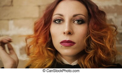 woman with red curly hair preens - Beautiful young woman...