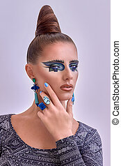 Portrait of beautiful model. Fashion style, geometry makeup and hairstyle.