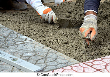 workers paving walkway - picture of a workers paving walkway...