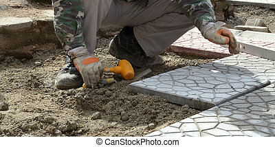 workers paving walkway Men at work concept - picture of a...