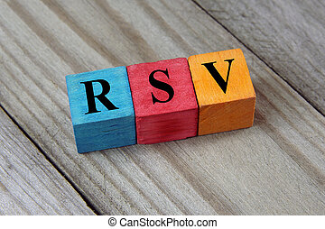 RSV (Respiratory Syncitial Virus) acronym on colorful wooden...