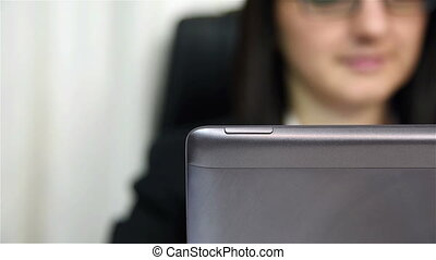 Businesswoman Using Laptop With Touchscreen, Close Up