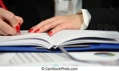 Woman Writes On Notepad - Woman Accountant Calculates Profit...