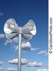 Loudspeakers - Chromed loudspeakers with sky background