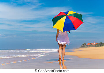 Girl with an colorful umbrella on the sandy beach - Girl...