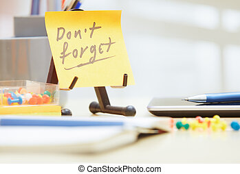 Do not forget text on adhesive note at office