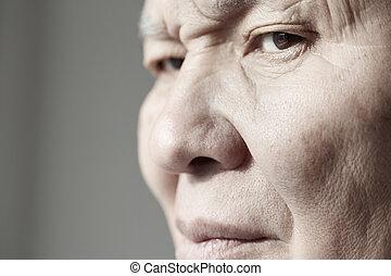 Elderly man - Face of elderly man looking at camera...