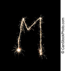 Letter M drew with spakrs on a black background.