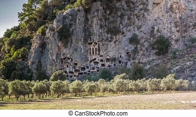 Lycian rock-cut tombs in the form of temple fronts carved...