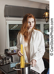 woman cooking pasta in the kitchen